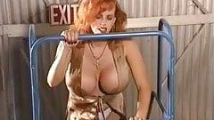 Redhead mature with awesome looking fake tits