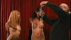 Two gorgeous, sexy Asian chicks are bound, play with clamps, lick each other