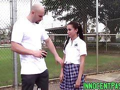 Petite brunette teen Kharlie Stone gags on massive schlong
