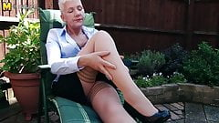 Naughty British mature lady masturbating in garden