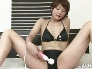 Japanese AV model Saori enjoys toying her pussy