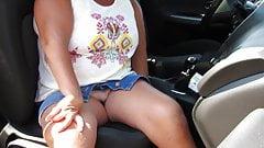 Nina in the car at phone