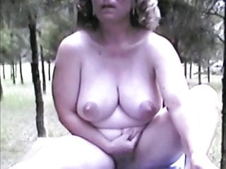 Mature Nude Female Outdoors On Table Extended Version