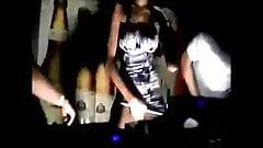 Two slutty girls flashing pussy in a club