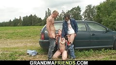 Hot mature threesome in the fields