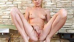 Leggy milf fingering her shaved pussy