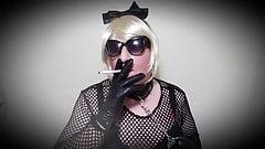 Fetish sissy slut Mandy smokes vs120 in leather gloves