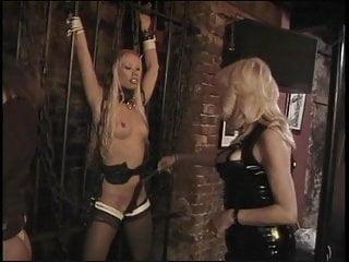 Dominatrix jails and restrains sexy MILF in her dungeon