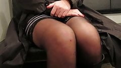 Black stockings and white garterbelt upskirt in a train