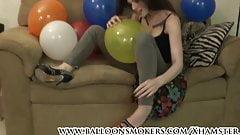 Indigo Augustine popping balloons in heels
