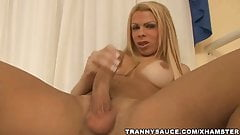 Big breasted blonde tranny babe tugs on her cock