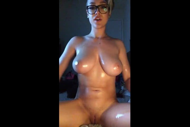 Cute Girl Oils Her Body And Fingers Her Pussy