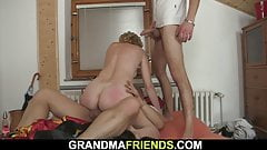 Small titted slim old woman pleases two men's Thumb