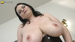 Gorgeous MILF shows off great tits and loves her dildo