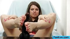 Mona Lee strokes plastic hammer with her foot