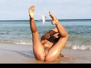 Teen beauty showing off her tiny bikini
