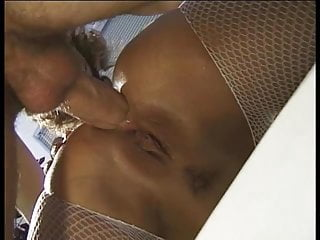 Hot black hair slut sucking stiff cock and gets fucked on a couch