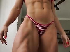 Sexy muscular woman in striped bikini