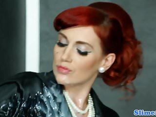 Bukkake redhead spreads pussy at gloryhole