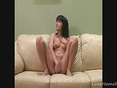 Horny milf loves masturbating on the couch