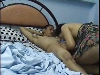 Older Asian woman swallos young guys load