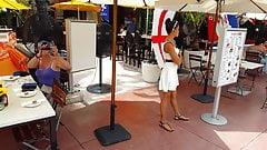 Candid voyeur beautiful Hostess in white dress