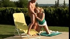 Poolside fun with horny blonde swallowing cock