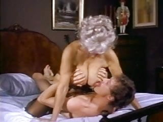 Hot mature with nice tits gets fucked by John Holmes and his legendary cock