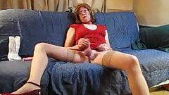 it`s very HOT  crossdresser in red dress suck her dildo and masturbate