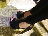 Candid high heels and sexy red toenails