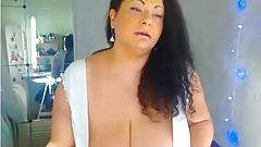 Sexy curvy huge breast MILF giving dildo a nice tit fuck