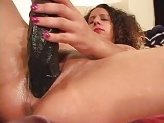 Amateur brunette uses huge dildo before taking black cock in bed