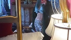 Bella Thorne admiring her abs in a mirror