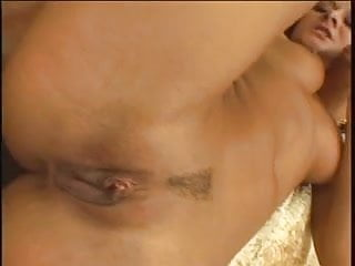 Dude jizzes on slut's face and nice rack after sex on a couch