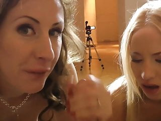 MILF beauty tugging cock during threesome