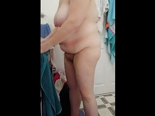 walking around the bathroom totally naked, hairy,