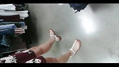 Beautiful brunette feet in elegant sandals