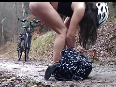 Nice ass on bicycle with chastity cage must pee. Too late