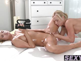 Blonde and cute lesbians playing with their cunts at massage