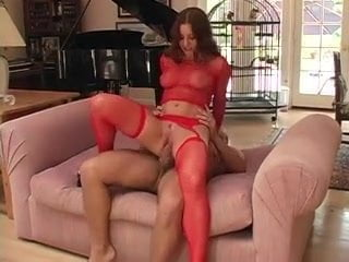 Pornstar Ariana Jollee does anal in red fishnet stockings