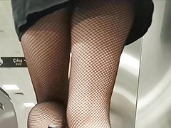 Sexy legs in Black Fishnet Pantyhose Upskirt