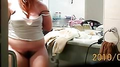 Examining Herself After Undressing Hidden Cam Clip