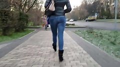 Girl with tight ass is walking down the street