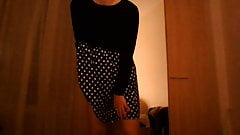 Crossdresser in polkadot dress having fun alone at home