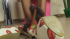 Girl in RHT Pantyhose plays with her shoes