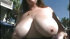 Brunette with Gigantic Tits Flashing in the Streets