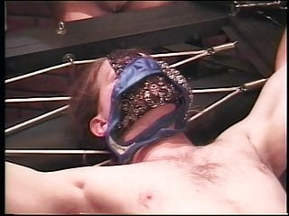 Dude gets restrained to bed by blonde leather dominatrix