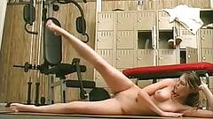 Sexy whore rides dildo among the gym equipment