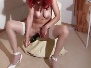 Redhead mature in stockings fucks wine bottle deep