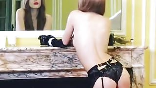 Bella Thorne topless from behind in stockings
